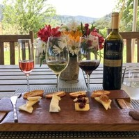 Amista Vineyards Wine & Cheese Pairing with Flowers & Vineyard Views
