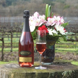 Sparkling Syrah from Amista Vineyards with Glass or Sparkling and Flowers in the Vineyard
