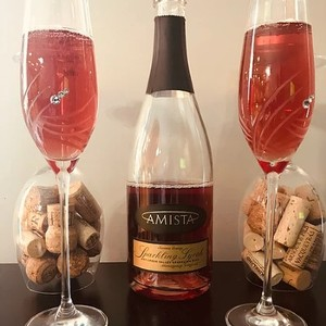 Amista Vineyards Sparkling Syrah, Two Festive Glasses with Bottle and Corks