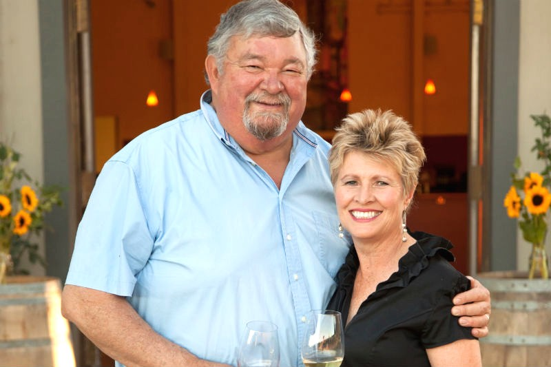 Amista Vineyards Proprietors, Mike and Vicky in front of tasting room